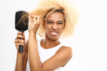 How to care for your hair dark-skinned young woman combs her hair brush