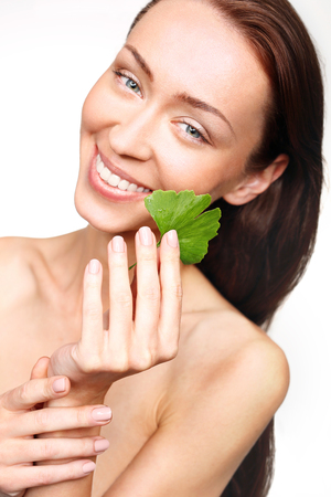 women subtle: Ginkgo, medicinal plant for a beautiful complexion. Stock Photo