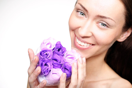 women subtle: Portrait of beautiful young happy woman with decorative soap for the face Stock Photo