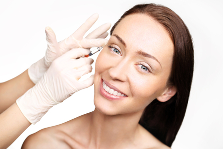 Portrait of a white woman during surgery filling facial wrinkles, Cosmetic is injected into facial skin cosmetics