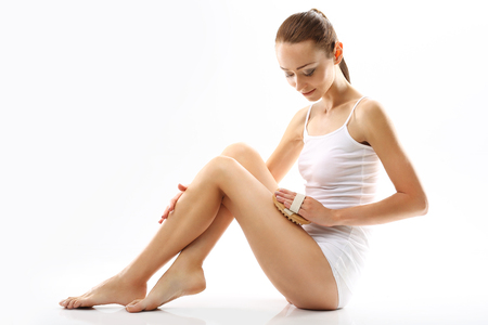shapely legs: Lymphatic massage woman massaging his feet. White young woman in white lingerie massaging his feet massager