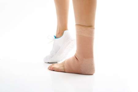 medical dressing: Foot injury, stabilizer ankle. Orthopaedic stabilizer ankle, feminine foot in dressing