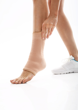 orthopaedic: Foot injury, stabilizer ankle. Orthopaedic stabilizer ankle, feminine foot in dressing