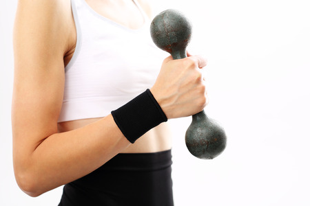 alloys: Woman with dumbbell and Stabilizing band on your wrist Stock Photo