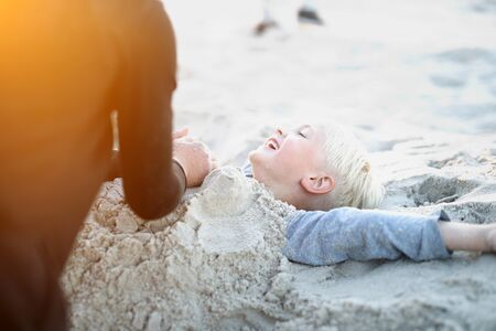 5 10 years old: Children on the beach playing in the sand Stock Photo