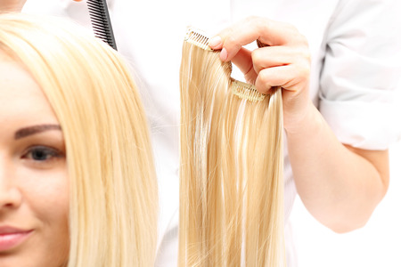 barber: Hair compaction. Barber prolongs the hair strands of hair buttoning