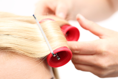hair curlers: The woman at the hairdresser, twirling hair curlers