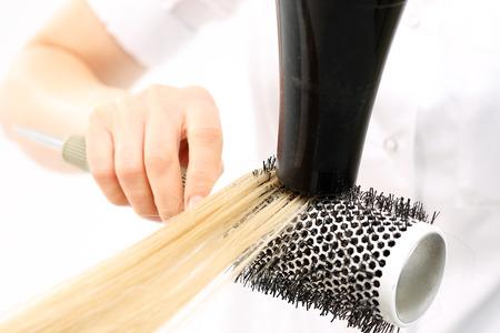 fingering: Medium-length hair, hairdresser models hair brush