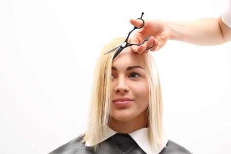 barber: Barber haircut woman in a hair salon Stock Photo