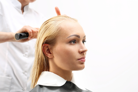 fingering: Hairdresser combing woman