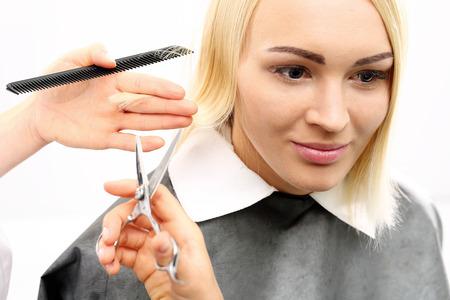 haircut: Hairdresser. Barber haircut woman in a hair salon