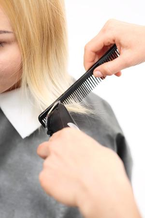 hair clippers: Cutting hair clippers. Woman hairdresser cuts hair tips