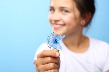crooked teeth: Child with orthodontic appliance