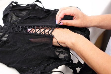 lacing: Corset lacing in the manufacturing plant underwear. Stock Photo