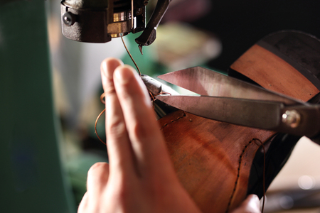 vesicle: Sewing machine. shoemaker sews shoes Stock Photo