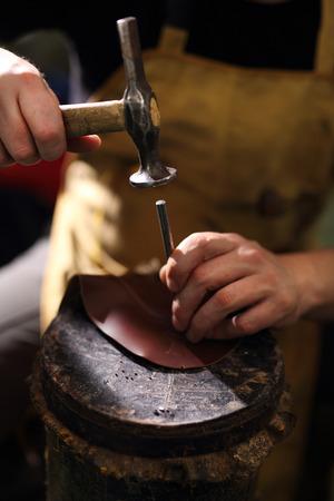 suede belt: Work shoemaker, an artist craftsman Stock Photo