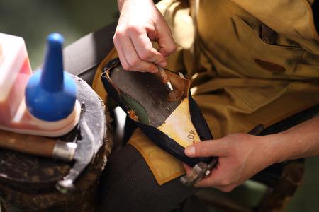 loafers: Shoemaker. Cobbler shoemaker sews elegant shoes