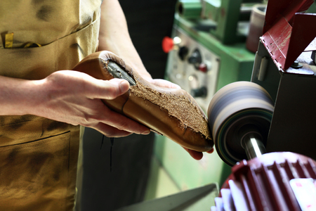 made to measure: Polishing shoes. Polisher cobbler polishes on brown shoes