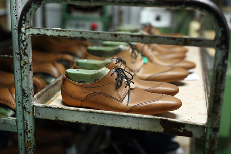 mens shoes: Bookcase in the studio shoemaker to the set of elegant pairs of mens shoes
