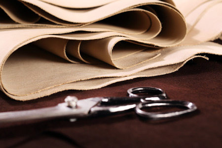 The composition of brown and vanilla leather and shoe accessories
