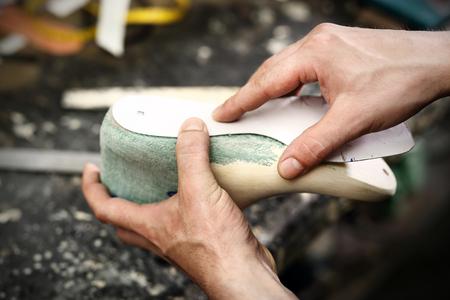 Work shoemaker, an artist craftsman Stock Photo