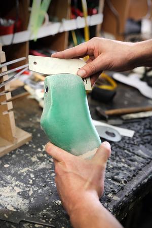 made to measure: Shoemaker. Cobbler shoemaker sews elegant shoes
