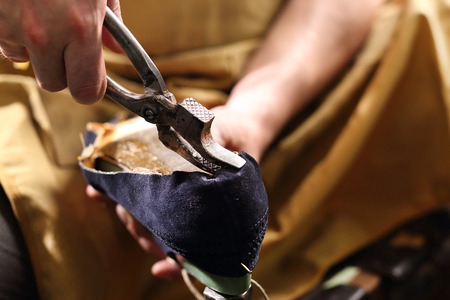 made to measure: Designing shoes, occupation shoemaker Stock Photo
