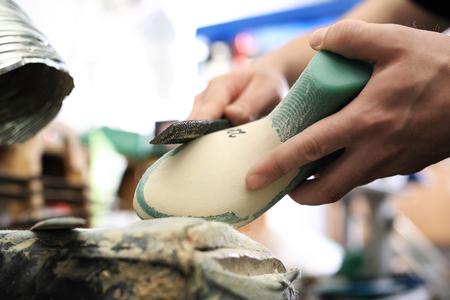 vesicle: Shoemaker. Handsewn shoes.