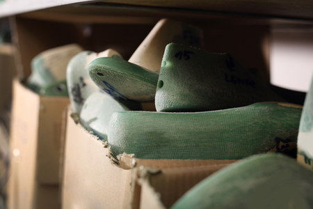 vesicle: Hooves shoemaker. Bookcase in shoemaking workshop with profiled hooves Stock Photo