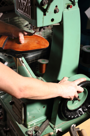 suede belt: Shoemaker sews shoes. Shoemaker manually performs shoes in the studio craft