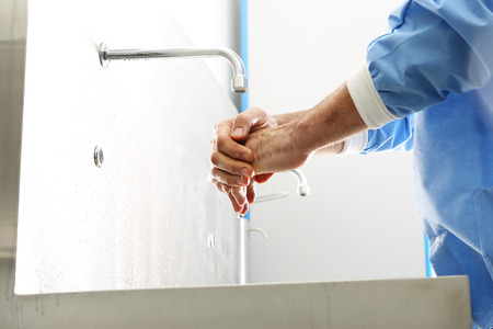 Surgical hand disinfection. The doctor washes his hands, disinfect Their hands before surgery Stock Photo