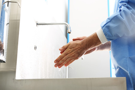 disinfect: The doctor disinfects his hands. The doctor washes his hands, disinfect Their hands before surgery