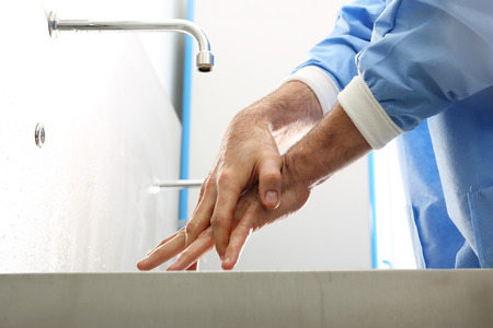 his: The doctor disinfects his hands.