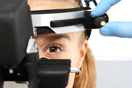 eye doctor: Binocular ophthalmoscope, an eye examination at an ophthalmologist