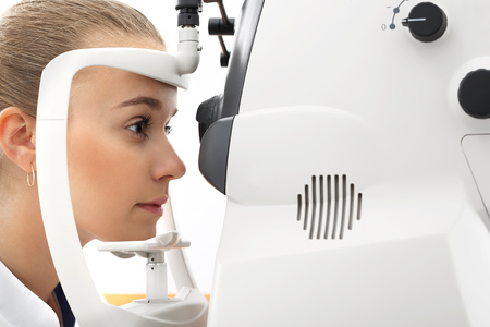 fundus: Computer vision test. Ophthalmologist, the patient on the study eye. Stock Photo