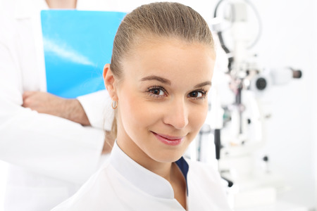 visual therapy: Ophthalmologist. A student of medicine at practice. Stock Photo