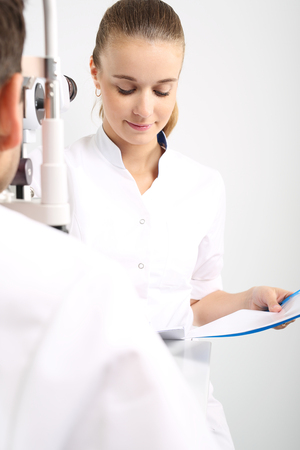 refractive: Eye examination. The patient during an eye examination at the eye clinic