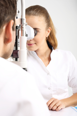 farsighted: Computer vision test. The patient during an eye examination at the eye clinic