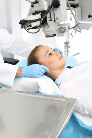 anesthesiologist: Eye doctor during the treatment of refractive vision surgery Stock Photo
