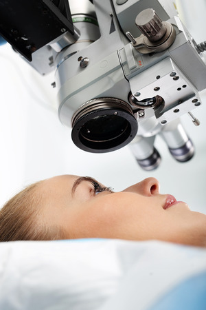 laser surgery: Eye clinic, laser vision correction. Ophthalmologist Stock Photo