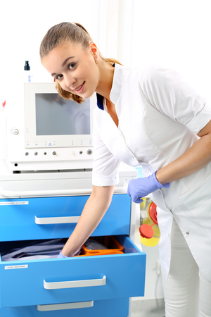 A nurse prepares an injection