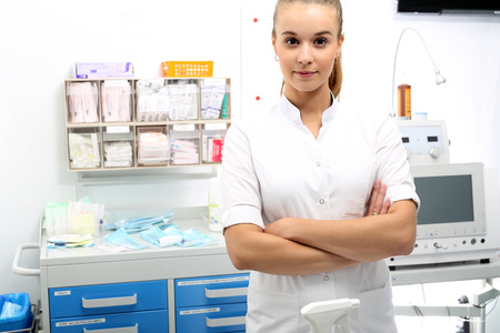 injection woman: Anaesthesiologist. Stock Photo
