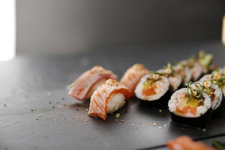 master: Sushi. Sushi master prepares futomaki