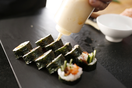 roll bar: Classic Japanese sushi served on a stone plate