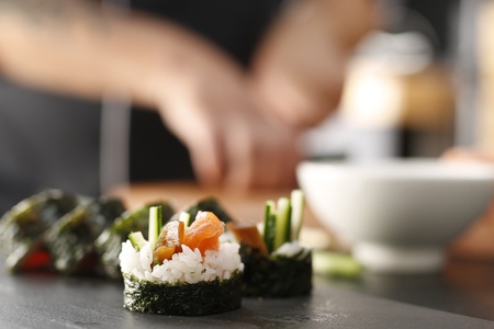 replaces: Classic thick rolls futomaki served on a stone plate