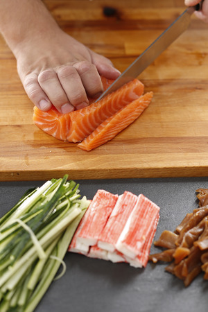 replaces: How to prepare sushi. Twisting sushi rolls on a bamboo mat