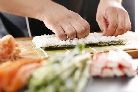 tuna mayo: Master sushi knife slicing sushi rolls