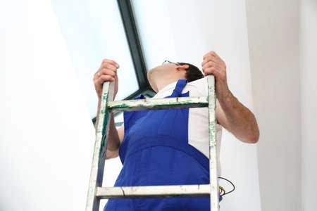 the assembler: Skylights, professional company assembler. Stock Photo