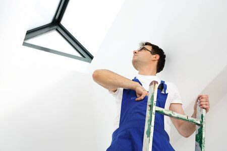assembler: Skylights, professional company assembler. Stock Photo
