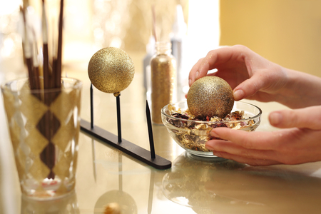 gilding: Preparation for the Christmas holidays, decorating glass ornaments